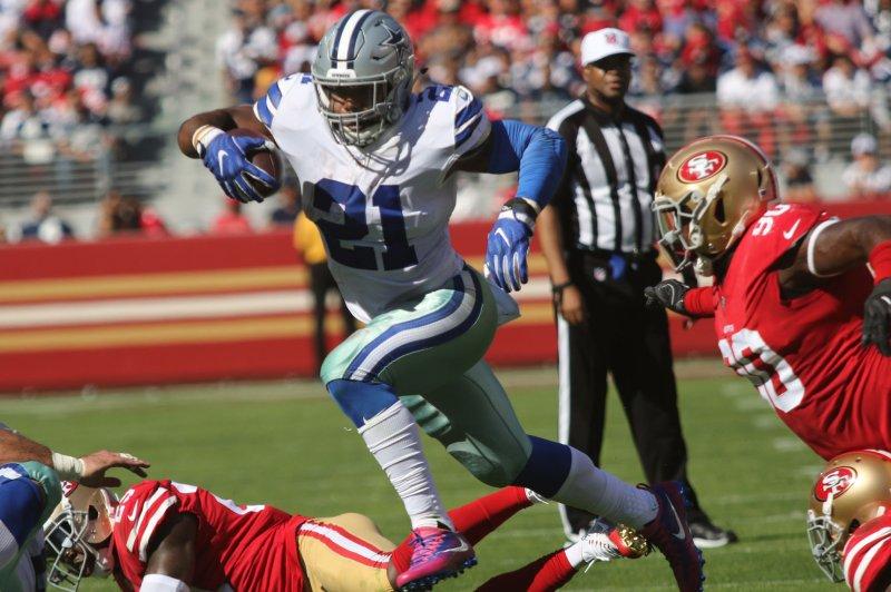 Dallas Cowboys' Ezekiel Elliott (21) runs against the San Francisco 49ers in the second half on October 22 at Levi's Stadium in Santa Clara, Calif. Photo by Bruce Gordon/UPI