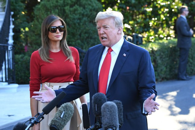 President Donald Trump talks to reporters Tuesday prior to departing for Britain for the NATO summit. Photo by Pat Benic/UPI