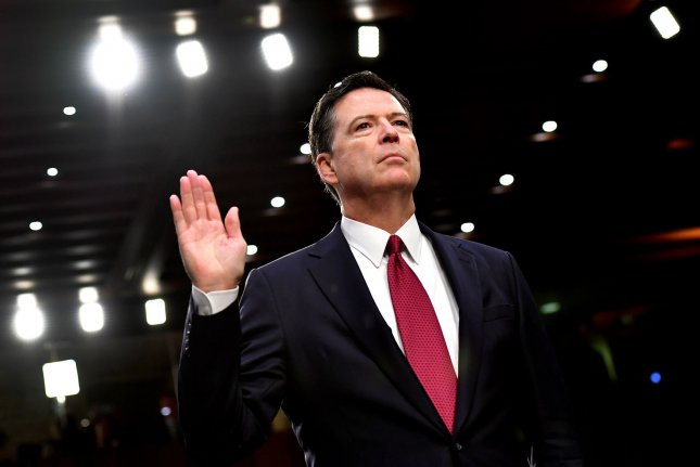 Former FBI Director James Comey is sworn-in prior to testifying at a hearing of the Senate Select Intelligence Committee on Capitol Hill on June 8, 2017. Photo by Kevin Dietsch/UPI