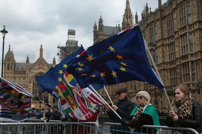 Brexit protesters hold EU flags outside the U.K. Houses of Parliament on December 12, 2018. Photo by Hugo Philpott/UPI