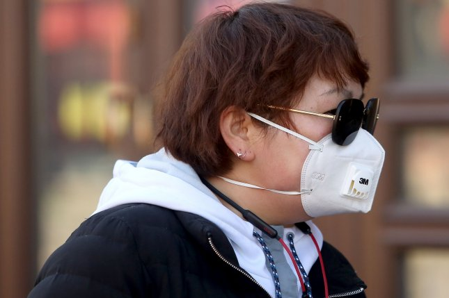 A Chinese woman wears a protective face mask on February 27, 2020, in Beijing as the threat from the deadly coronavirus continues. Photo by Stephen Shaver/UPI