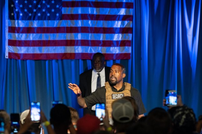 Kanye West wears a bulletproof vest at his initial campaign event in North Charleston, S.C., on July 19. West did not qualify for the ballot in Wisconsin on Thursday because his paperwork was filed late, officials said. File Photo by Richard Ellis/UPI