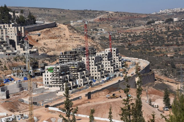 An overview of new Jewish housing in the Ramot neighborhood, across the green line, or pre-1967 borders, in east Jerusalem, Israel. On Sunday, Jerusalem's planning committee approved the construction of 566 Jewish homes in Pisgat Ze'ev, Ramot and Ramat Shlomo and 105 houses for Arabs in east Jerusalem. Photo by Debbie Hill/UPI
