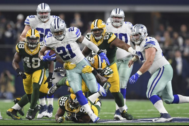Dallas Cowboys running back Ezekiel Elliott (21) runs for a first down against the Green Bay Packers in the NFC divisional playoff game at AT&T Stadium in Arlington, Texas on January 15, 2017. Photo by Shane Roper/UPI