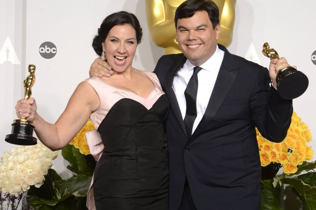 Songwriters Kristen Anderson-Lopez (L) and Robert Lopez hold their awards for Best Achievement in Music Written for Motion Pictures, Original Song, for Let It Go from Frozen, at the 86th Academy Awards on March 2, 2014 in Los Angeles. Anderson-Lopez's new Broadway musical In Transit is closing this weekend. File Photo by Phil McCarten/UPI