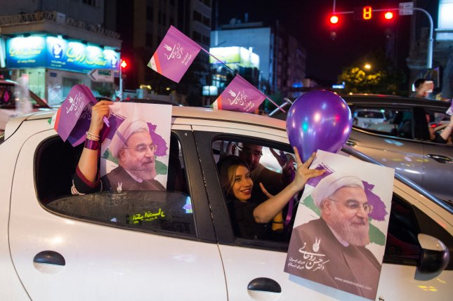 Supporters of Iranian President Hassan Rouhani rally in the streets if Tehran, Iran ahead of the country's presidential election on Friday. Rouhani defeated conservative candidate Ebrahim Raisi by claiming 57 percent of the vote in order to win a second term in office.  Photo by Ali Mohammadi/UPI