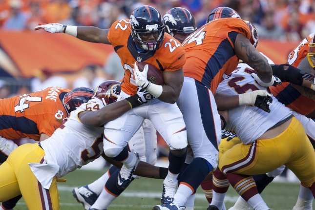 Former Denver Broncos running back C.J. Anderson (22) runs the ball against the Washington Redskins on October 27, 2013 at Sports Authority Field at Mile High in Denver. File photo by Gary C. Caskey/UPI