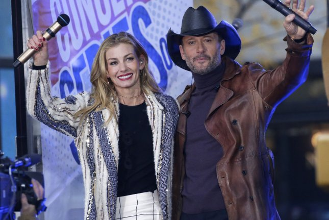 Country music couple Tim McGraw (R) and Faith Hill. McGraw wished his wife a happy birthday on social media. File Photo by John Angelillo/UPI