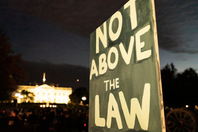 Protestors gather at Lafayette Park in front of the White House for a campaign rally to Protect Mueller on Nov. 8. President Donald Trump's appointment of Matthew Whitaker as acting attorney general has been criticized because it was done without Senate confirmation. Photo by Ken Cedeno/UPI
