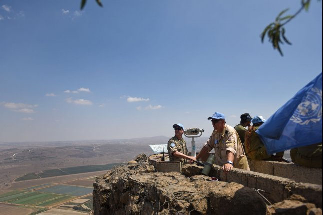 United Nations observers monitor the Israeli-Syria border from Mt. Bental overlooking the Israeli-annexed Golan Heights in August 2015. File Photo by Debbie Hill/ UPI