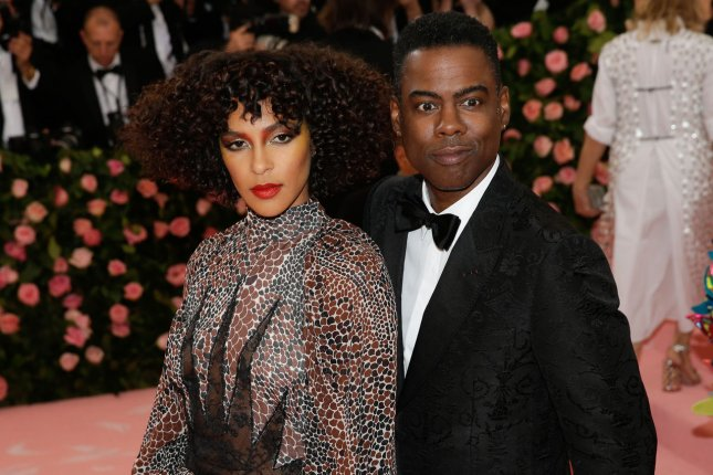 Chris Rock (R) with Megalyn Echikunwoke. The comedian is helping Lionsgate reboot horror series Saw. File Photo by John Angelillo/UPI