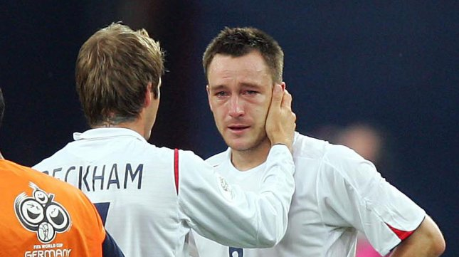 England's David Beckham (L) consoles John Terry in 2006. Terry is on trial for racism charges. (UPI Photo/Chris Brunskill)