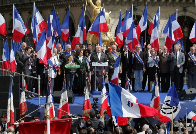 Supporters of former ultra-nationalist leader of the National Front Party (FN) Jean Marie Le Pen (C) wave the country's flag at a rally in Paris to mark the annual party's celebration of Joan of Arc, May 1, 2008. Le Pen was succeeded by his daughter, Marine. (UPI Photo/Eco Clement)