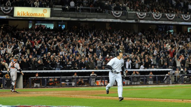New York Yankees Raul Ibanez watches his walk off home run in the twelfth inning in game 3 of the ALDS against the Baltimore Orioles at Yankee Stadium in New York City on October 10, 2012. UPI/Jason Szenes