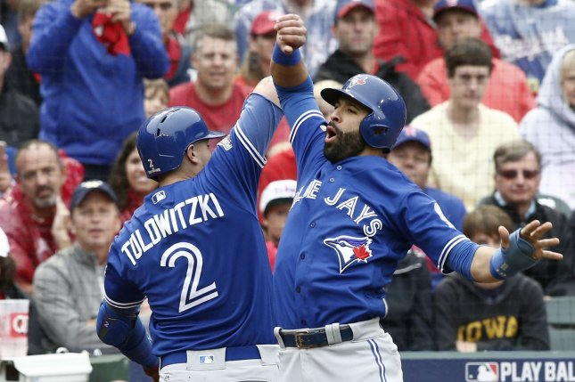 Toronto Blue Jays' Troy Tulowitzki (2) and Jose Bautista celebrate after scoring against the Texas Rangers on Tulowitzki's two-run home run in the second inning of game 2 of the American League Division Series at Globe Life Park in Arlington, Texas on October 7, 2016. Toronto defeated Texas 11-1. Photo by Mike Stone/UPI