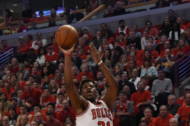 Chicago Bulls guard Jimmy Butler (21) attempts a difficult shot. Butler had a team-high 25 points against the Nets to help guide the Bulls to the win. File photo by David Banks/UPI