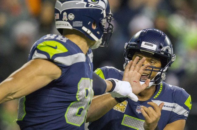 Seattle Seahawks tight end Jimmy Graham (88) fist bumps quarterback Russell Wilson (3). Photo by Jim Bryant/UPI