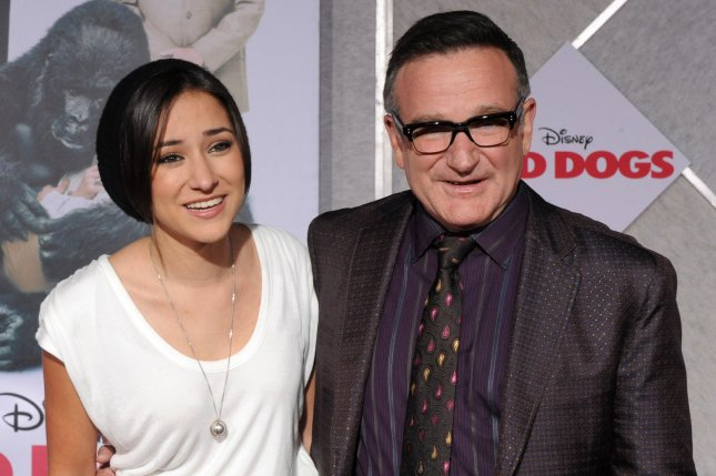 Zelda Williams (L), pictured with Robin Williams, congratulated brother Cody Williams after he married on their late dad's birthday. File Photo by Jim Ruymen/UPI