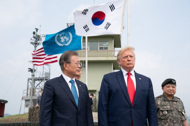 U.S. President Donald Trump (R) has asked South Korea's President Moon Jae-in (L) to pay more for defense costs on the Peninsula. File Photo by Shealah Craighead/White House
