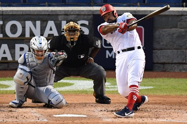 Washington Nationals first baseman Howie Kendrick hits a single in the third inning against the New York Mets at Nationals Park in Washington, D.C., on Tuesday night. Photo by Kevin Dietsch/UPI