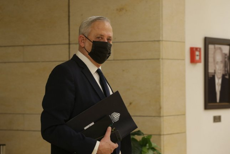 Israeli defense minister Benny Gantz leaves the Israeli Knesset Wednesday after voting to dissolve the legislative body, in Jerusalem, Israel. Photo by Alex Kolomoisky/UPI/Pool