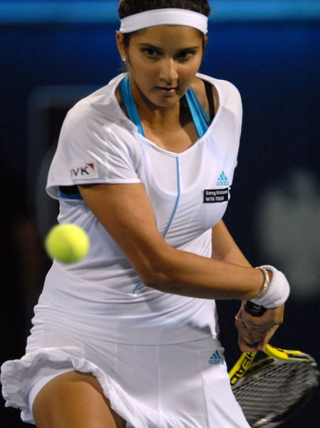 Sania Mirza, shown in a 2008 file photo, posted one of four upset wins Wednesday at the WTA tournament in China. (UPI Photo/Norbert Schiller)