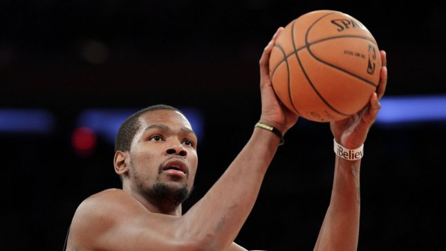 ad233e91ea7 Oklahoma City Thunder Kevin Durant shoots a free throw in the first quarter  against the New York Knicks. Durant proposed to WNBA star Monica Wright  over the ...