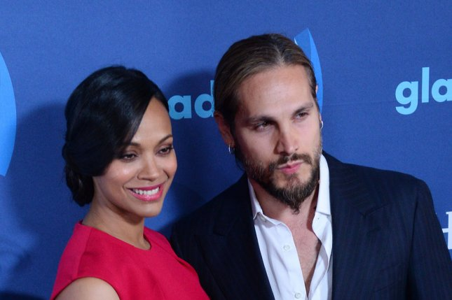 Zoe Saldana (L) revealed husband Marco took her surname after they married. File photo by Jim Ruymen/UPI