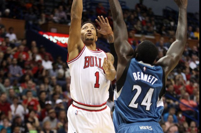 Chicago Bulls' Derrick Rose shoots up and over former Minnesota Timberwolves forward Anthony Bennett in the second quarter at the Scottrade Center in St. Louis on October 24, 2014. UPI/Bill Greenblatt