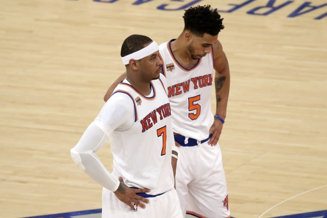 New York Knicks' Carmelo Anthony and Courtney Lee stand on the court in the first half against the Indiana Pacers at Madison Square Garden in New York City on December 20, 2016. Photo by John Angelillo/UPI