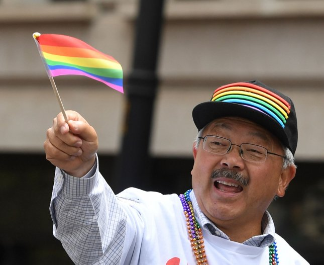 San Francisco Mayor Edmund Lee waves a flag in the annual LGBT Pride Parade in San Francisco on June 25. On December 15, 1973, the American Psychiatric Association reversed its longstanding position and declared that being gay isn't a mental illness. File Photo by Terry Schmitt/UPI