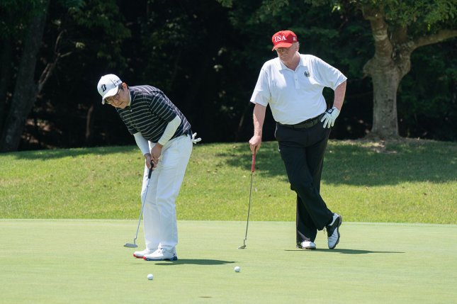 President Donald Trump watches as Japanese Prime Minister Shinzo Abe makes a putt during their golf game on May 26 at the Mobara Country Club in Chiba, Japan. File Photo by Shealah Craighead/White House