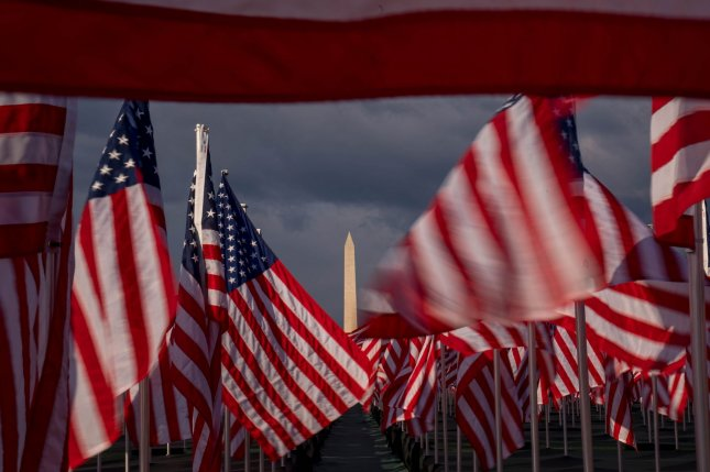 Thousands of flags are planted on the National Mall in Washington, D.C., to represent more than 400,000 Americans who have died so far of the coronavirus disease. The Washington Monument can be seen in the distance. Photo by Ken Cedeno/UPI