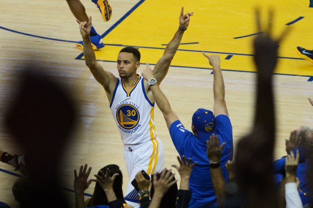 8b9d103aa897 Golden State Warriors  Stephen Curry (30) celebrates his 400th three point  shot of the season against the Memphis Grizzles at Oracle Arena in Oakland