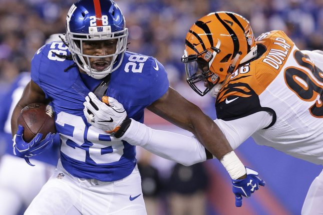 Cincinnati Bengals' Carlos Dunlop grabs the jersey of New York Giants running back Paul Perkins in the first half in Week 10 of the NFL season on November 14 at MetLife Stadium in East Rutherford, N.J. File photo by John Angelillo/UPI