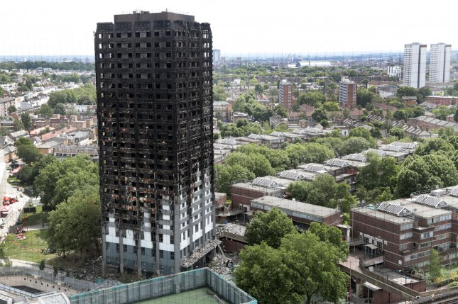 A view of the 24-story Grenfell Tower in west London on Friday shows large-scale devastation of the building caused by a massive fire earlier this week, which killed at least 30 people and injured dozens more. Photo by Hugo Philpott/UPI