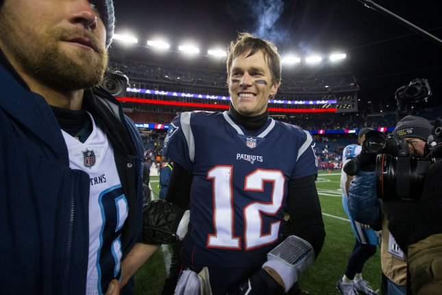 37c4c572a New England Patriots quarterback Tom Brady (12) shakes hands with Tennessee  Titans quarterback Matt Cassel (16) after the Patriots defeated the Titans  in ...