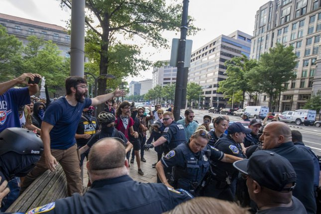 Protesters clash near President Donald Trump's hotel in Washington, D.C., on July 6, 2019. A Gallup poll Monday said Republicans in the United States are far more satisfied with American life than are Democrats. File Photo by Tasos Katopodis/UPI