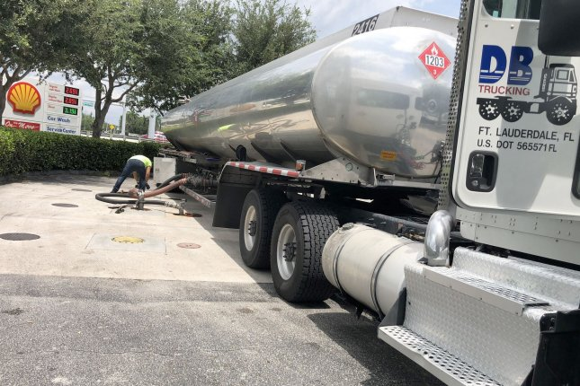 An oil tanker truck deposits 9,000 gallons of gasoline at a fueling station in South Florida. Gas prices worldwide have fallen on weaker demand this year due to the coronavirus pandemic. File Photo by Gary I Rothstein/UPI