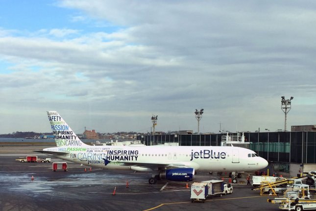 A JetBlue airliner is seen at New York City's LaGuardia Airport. The carrier said Wednesday it will begin service to London from the city's John F. Kennedy International Airport this summer. File Photo by Todd Bomser/UPI