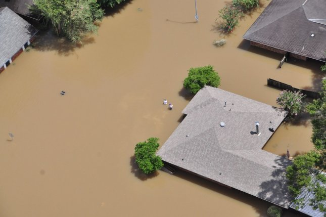 An aerial view of a flooded area in Baton Rouge, La., on August 15. President Barack Obama visited the area on Tuesday, albeit a little late in some critics' estimation, and toured many of the damaged areas. During the visit, he praised FEMA for its quick response and pledged continuing federal support for Louisiana residents affected by the disaster. Photo by Melissa Leake/U.S. Coast Guard/UPI
