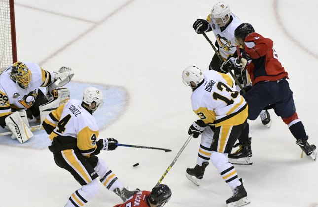 Washington Capitals left wing Alex Ovechkin (8) is defended by Pittsburgh Penguins defenseman Olli Maatta (3), center Nick Bonino (13) and defenseman Justin Schultz (4) in front of goalie Marc-Andre Fleury (29) at the Verizon Center in Washington, D.C. on May 6, 2017. The Capitals defeated the Penguins, 4-2, to stave off elimination. Photo by Mark Goldman/UPI
