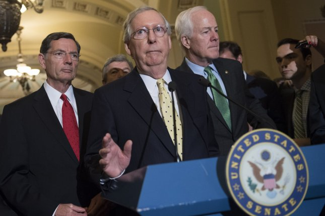 Senate Majority Leader Mitch McConnell, R-Ky., speaks to the media on the healthcare vote on Capitol Hill in Washington, D.C. on July 18, 2017. McConnell was joined by Sen. John Cornyn, R-Texas, (R) and Sen. John Barrasso (2nd-L), R-Wyo. McConnell announced he will pull the Republican health care bill. A new survey shows increasing support for the ACA and deep divisions among Republicans on repeal and replace. Photo by Kevin Dietsch/UPI
