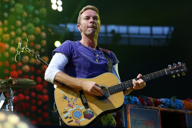 Chris Martin of Coldplay performs in concert at the Stade de France near Paris on July 15. The band performed a new song Houston following the aftermath of Hurricane Harvey. File Photo by David Silpa/UPI