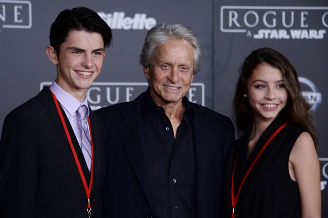 Michael Douglas (C), pictured with son Dylan (L) and daughter Carys, shared a sweet moment with Dylan ahead of his high school prom. File Photo by Jim Ruymen/UPI