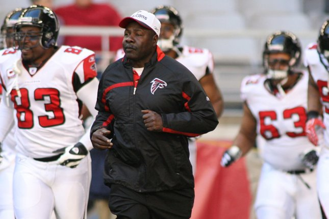 e7aba3aaca4 Former Atlanta Falcons interim head coach and longtime assistant positional  coach Emmitt Thomas leads the team out before the start of the Falcons   game ...