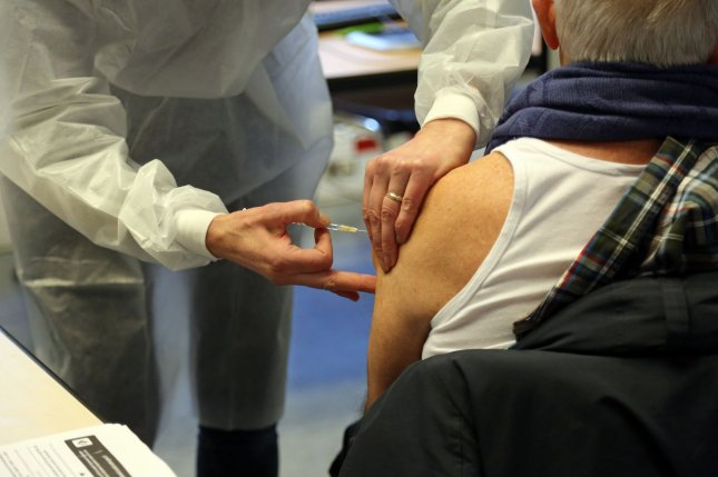 A French medical worker administers a shot containing the COVID-19 vaccine at the town hall of the 5th district in Paris on Monday. Photo by David Silpa/UPI