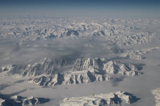 Researchers say new research on melting ice and rising seas nearly 15,000 years ago could help to understand and plan for the possibility of melting at the Greenland Ice Sheet, pictured from 40,000 feet in 2016. File Photo by NASA/UPI