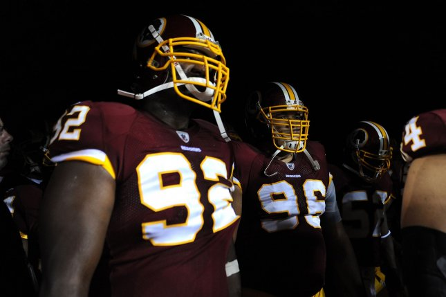 Albert Haynesworth (R), then with the Washington Redskins, at FedEx Field in Landover, Md., Sept. 12, 2010. UPI/Kevin Dietsch