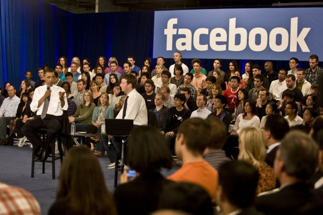 President Barak Obama speaks at a town hall at Facebook headquarters, with Facebook CEO Mark Zuckerberg (R) in Palo Alto, California on April 20, 2011. UPI/Terry Schmitt